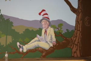 Nancy wanted to nod to Dr. Seuss so the Ellen portrait wears the Cat in the Hat hat
